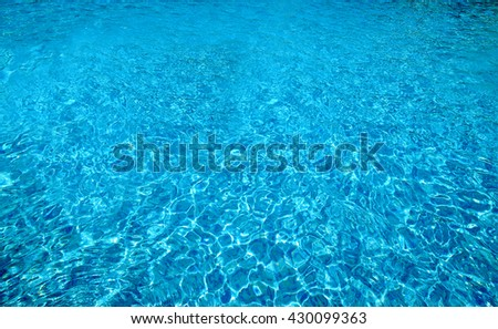 light reflecting in a ripple pattern in water, swimming pool - stock photo