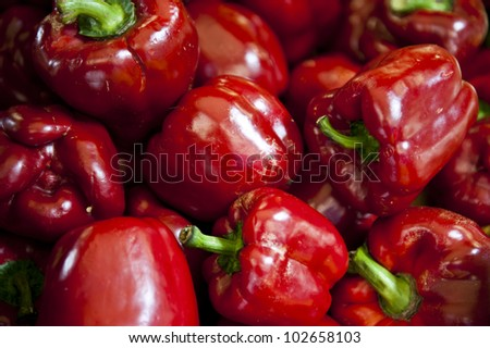 Light reflecting on red bell peppers giving them a shiny appearance. - stock photo