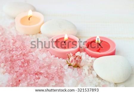 Light romantic calming spa background, pink sea salt candles flowers, soft light, soft focus - stock photo