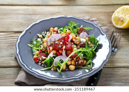 Light salad with fruits and chickpea, food - stock photo