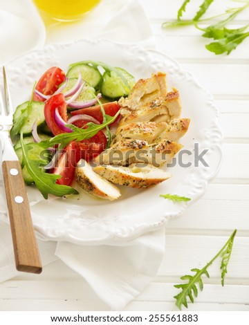 Light salad with roasted chicken breast. - stock photo