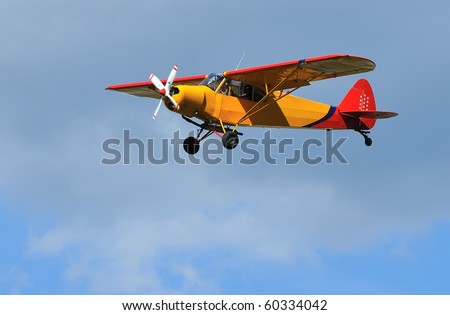 light 2-seater aircraft coming in to land. Piper Super Cub, ideal for short take off and landing STOL - stock photo