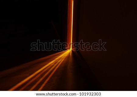 light shining on the floor through door gap - stock photo