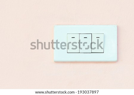 Light switch on a wall - stock photo