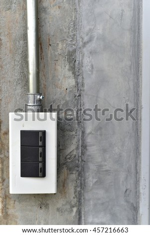 light switches on cement wall.white light switch - stock photo