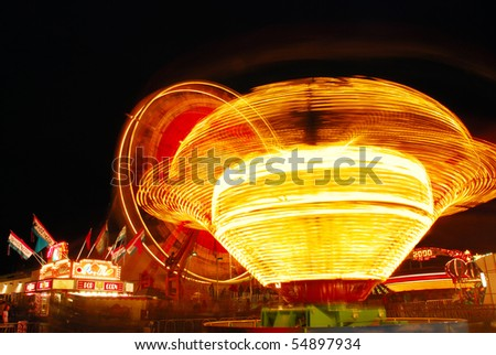 light Tornado, part of the midway at the 2009 Douglas County Fair in Roseburg Oregon at night. - stock photo