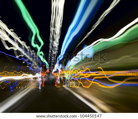 Light traces of the machine in a long tunnel. Long exposure - stock photo