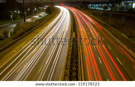 Light trail on a busy motorway - stock photo