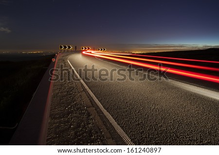light trail on infamous cat and fiddle road at night, macclesfield to buxton - stock photo