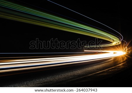 Light traillight trails in tunnel. Art image. Long exposure photo taken in a tunnel. - stock photo