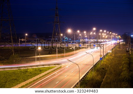 Light trails at night on the highway - stock photo