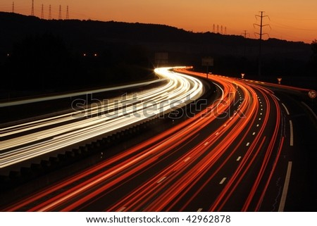 Light trails from cars travelling down-2 - stock photo