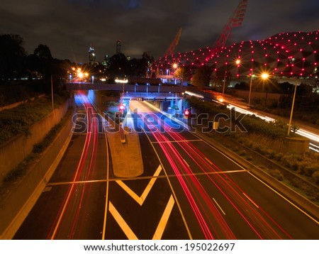 light trails left by traffic travelling into melbourne australia - stock photo