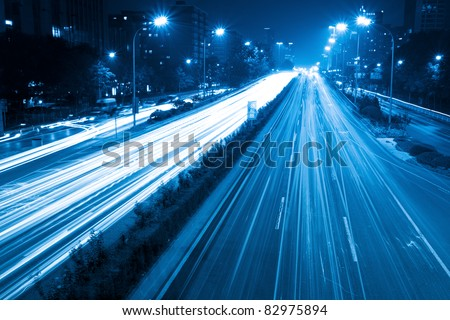 light trails on the street with blue tone in beijing,China - stock photo