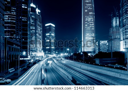 light trails on the street with modern building background in shanghai,China - stock photo