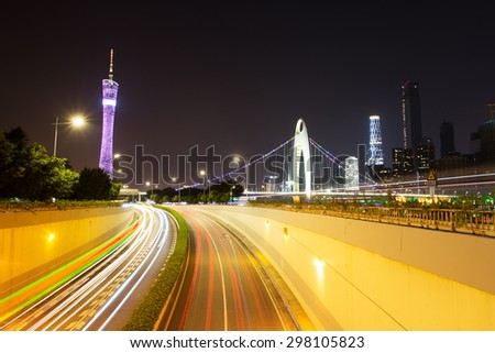 light trails on urban road - stock photo
