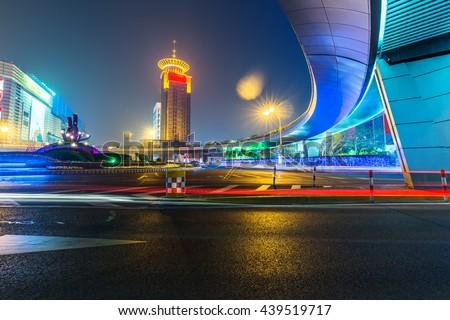 light trails through pedestrian bridge ,shanghai - stock photo