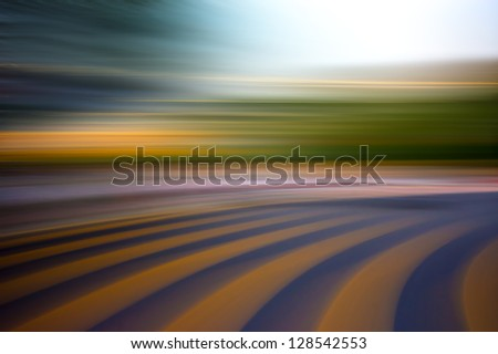 Light trails with motion blur effect - stock photo