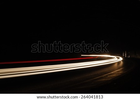 Light tralight trails in tunnel. Art image. Long exposure photo taken in a tunnel. - stock photo