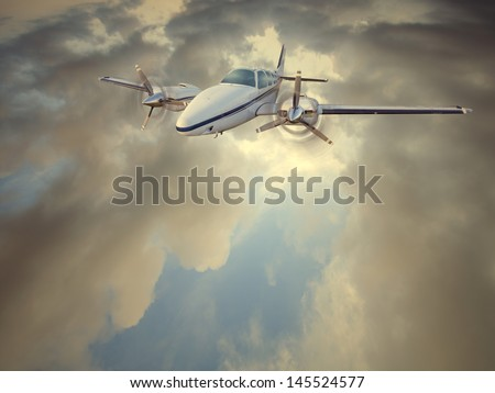 Light twin-engined piston aircraft in flight - stock photo