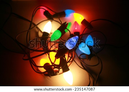 Light up Retro or Vintage Style Holiday Lights on white. 1950's era large bulb colored Christmas lights, in the colors of Red, Blue, Green, Yellow, Orange and Turquoise   - stock photo
