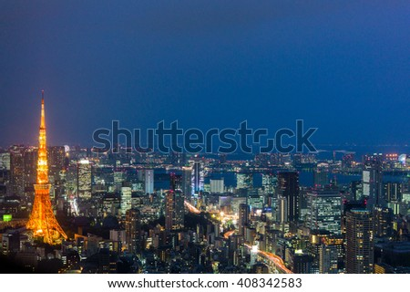Light up Tokyo Cityscape  view with Tokyo Tower at left of picture after sunset surrounded by other buildings in Tokyo, Japan - stock photo