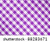 light violet checked fabric tablecloth - stock photo