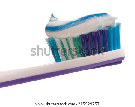 Light-violet toothbrush with toothpaste isolated on white background - stock photo