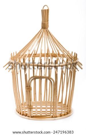 Light wooden bird cage on white - stock photo