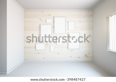 Light wooden wall with blank frames in empty room interior. Mock up, 3D Rendering - stock photo