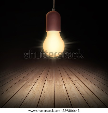 Lighted lamp on floor - stock photo