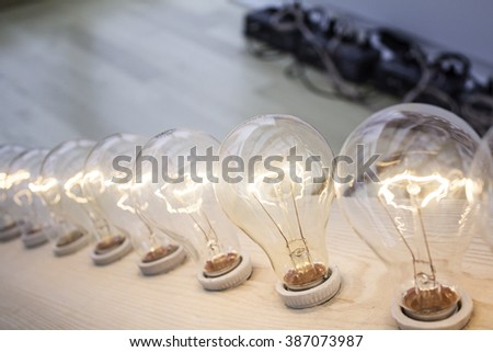 Lighted Light Bulbs on display, power and electricity - stock photo
