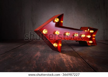 Lighted Red Marquee Arrow - stock photo