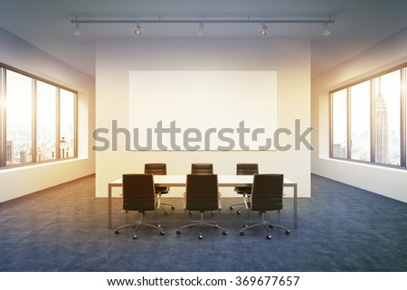 Lighted spacious meeting room in office building, windows on both sides, New York view, big table and six black leather armchairs around it. White board on the back wall. Concept of negotiations - stock photo
