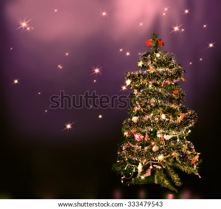 lighten Christmas tree on blue star sky   - stock photo