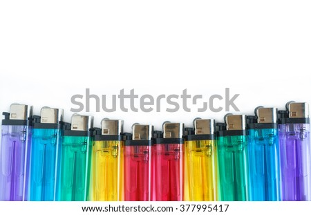 Lighter in colorful plastic with white background - stock photo