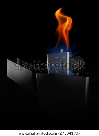 Lighter metal in the dark, at night - stock photo