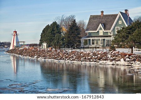 Lighthouse along picturesque waterfront of Charlottetown, Prince Edward Island, Canada. - stock photo