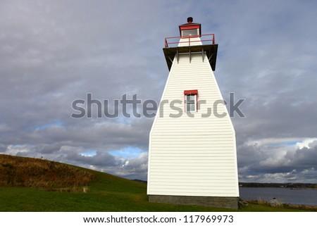 Lighthouse along the Atlantic coast of Nova Scotia - stock photo