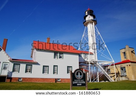 Lighthouse and residence at  Whitefish Point Lighthouse. The treacherous waters of Lake Superior on this coast  are dubbed the Graveyard Coast.  Great Lake Shipwreck  Museum, Michigan.  - stock photo
