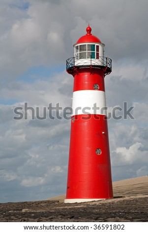 Lighthouse at a stormy day - stock photo