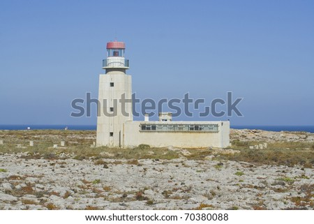 Lighthouse at Cape Sagres Point. This cape is the first neighbour of the southwesternmost point in Portugal - Cape St. Vincent - stock photo
