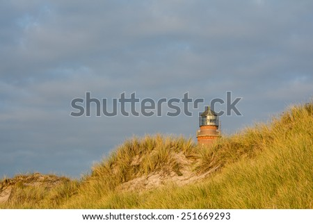 lighthouse at Darss Peninsula in Germany at sunset - stock photo