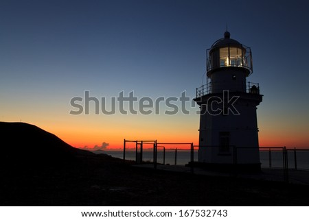 Lighthouse at dawn - stock photo