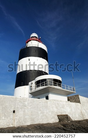 Lighthouse at Hook head in Ireland - stock photo