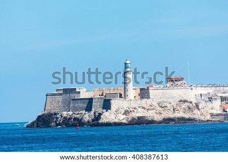 Lighthouse at Morro Castle looking out to the beautiful blue sea. El Morro fortress is at the entrance of the Havana Bay. Currently the Spanish militar installation is a tourist landmark - stock photo