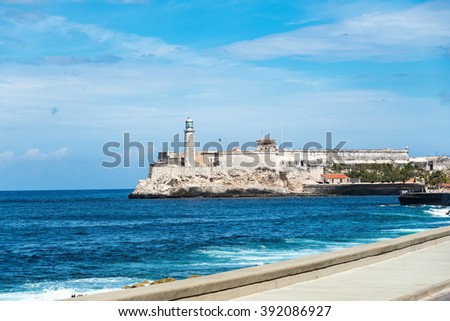 Lighthouse at Morro Castle looking out to the beautiful blue sea. The Morro Castle was a Spanish fortress defending the colonial city. Currently is a major tourist attraction and landmark - stock photo