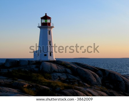 Lighthouse at Peggy's Cove Nova Scotia at dusk - stock photo