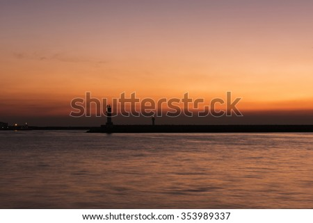 Lighthouse at sunset - stock photo