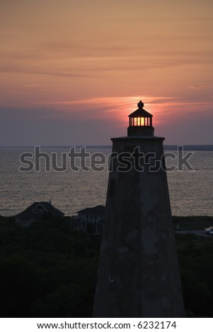 Lighthouse at sunset on Bald Head Island, North Carolina. - stock photo